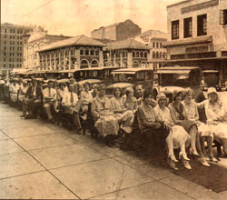 historic photograph of people on benches